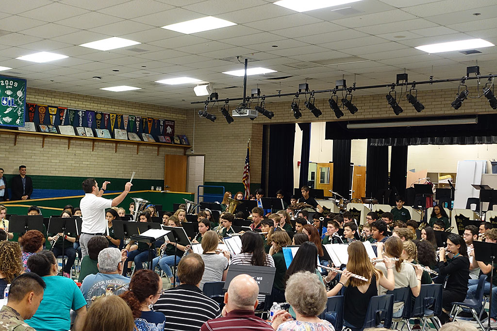 Tony Ruiz, Head Director at Churchill High School, conducting one of the Homecoming Concert Selections